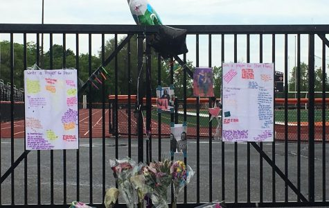 Friends show their love for their fellow classmate with an on campus memorial.