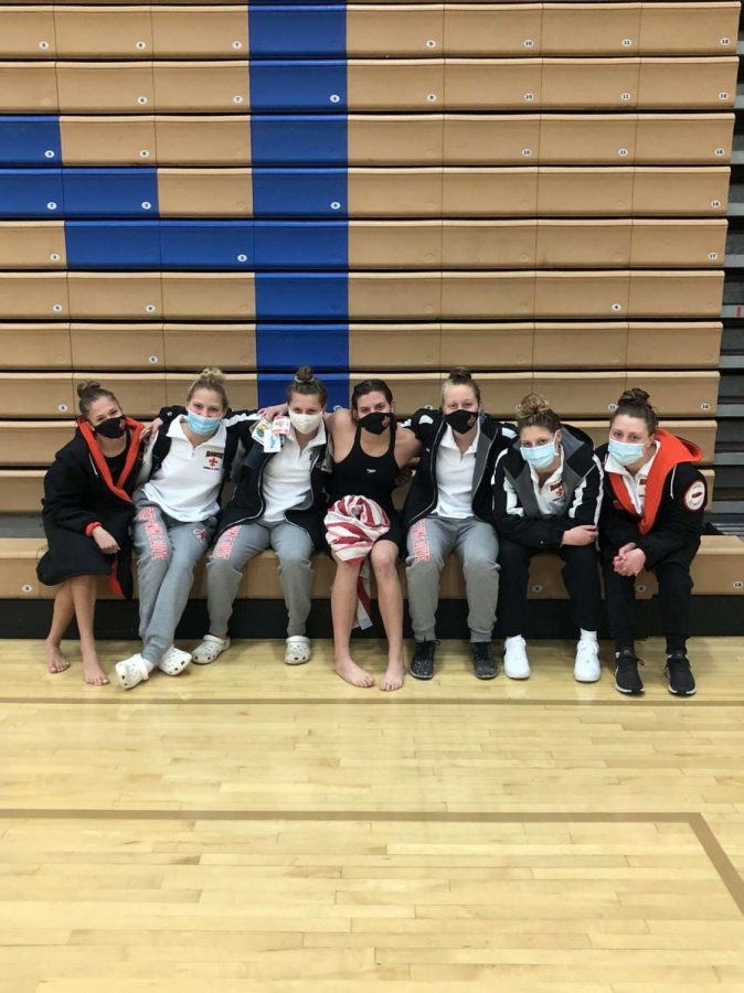 (From left to right) Elena Weber, Melissa Jacobucci, Payton Dorman, Lauren Swartz, Sophia Mruk, Molly Yetter, and Madison Supple after the sectional meet. Photo courtesy of Sophie Mruk.