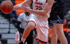 Senior Matt Peddy looks to pass as he drives towards the basket against North.
