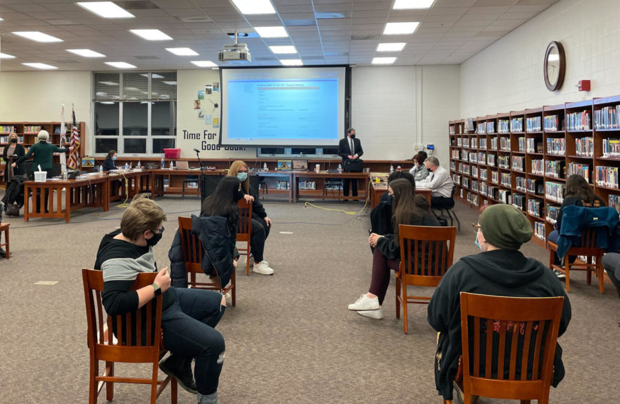 East students wait for the March 8 School Board Meeting at the Thompson Middle School library to begin. At this meeting, the Board voted to approve the implementation of Deep Equity.