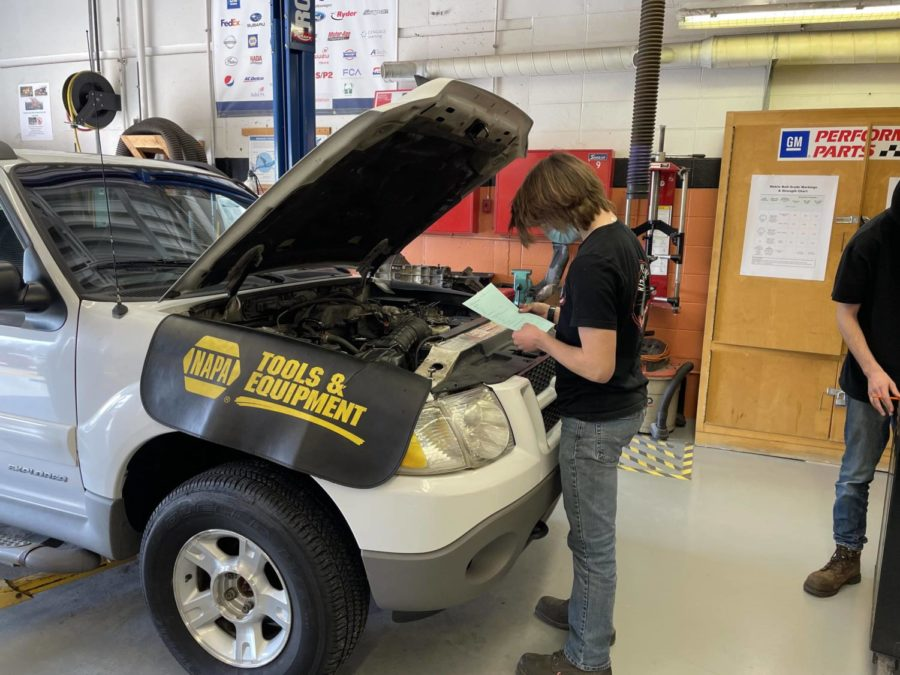 Junior Paul Beeson practices identifying car parts during an Autos class.