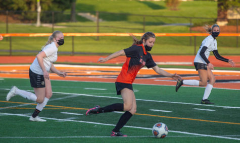 Senior Jenna Sitta sets up tot kick the ball. Photo by Dom DiPalermo.